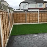artificial grass fenced